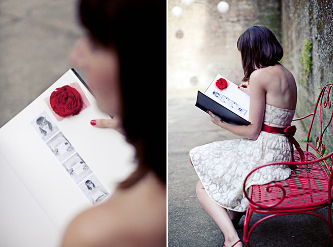 amelie style - sitting on red bench reading guestbook with photobooth strips
