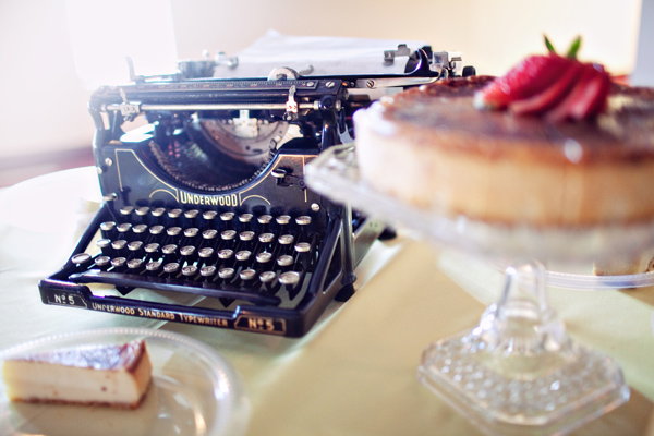 old typewriter; cheesecake on cake stand