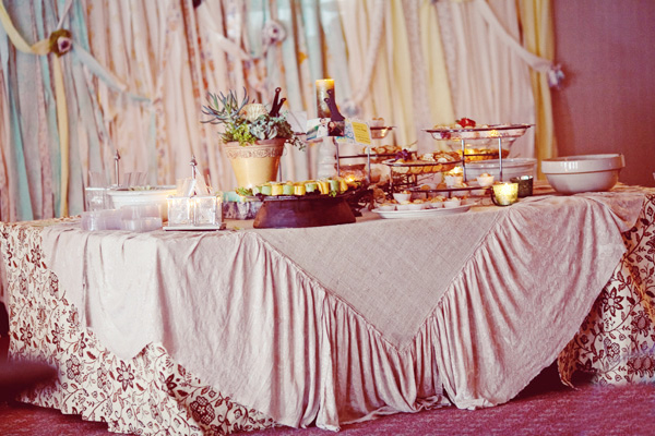 unique ttable covering; trays of food and centerpieces
