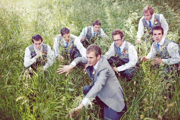 groom and attendants in the tall grass