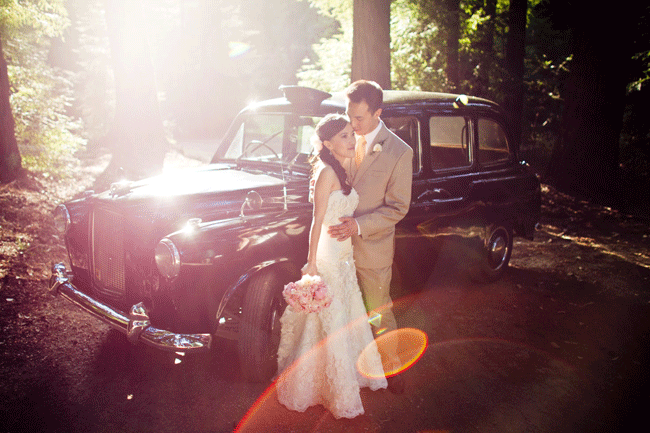 bride and groom stand in front of vintage car in woods at Nestldown