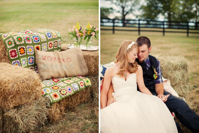 bride and groom sit on sofa made from hay bales