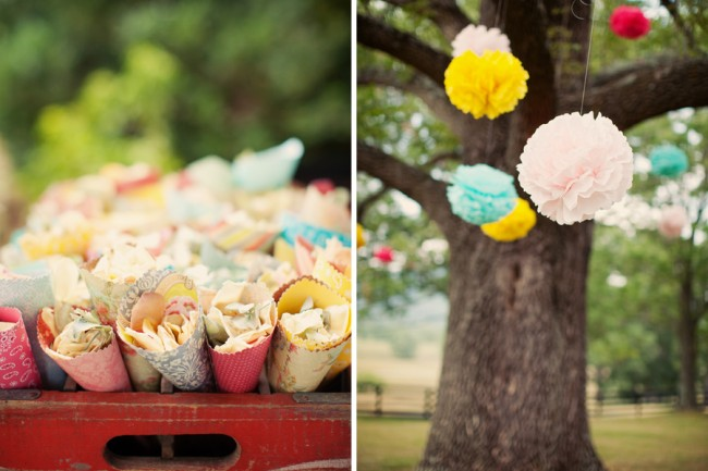 DIY paper cones and pom poms hanging from tree