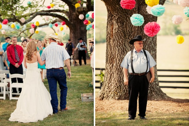 bride and father walk down outdoor aisle with colorful pom-poms in tree overhead