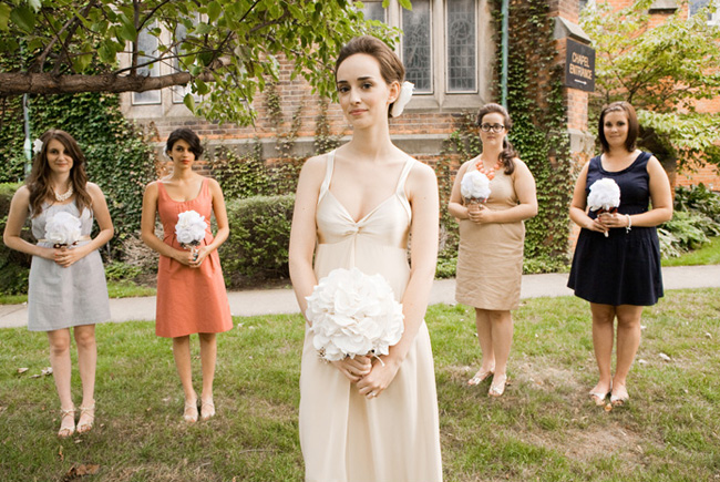 bride and bridesmaids in mismatched dresses holding fabric bouquets