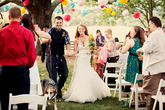 bride and groom recessional at outdoor Marriott Ranch ceremony with their pet dog