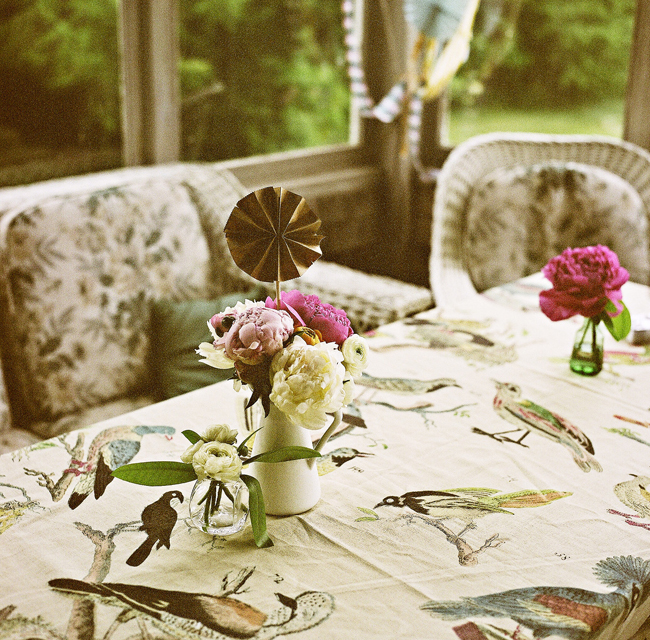 centerpiece decorations: paper pinwheels, streamers, and peonies