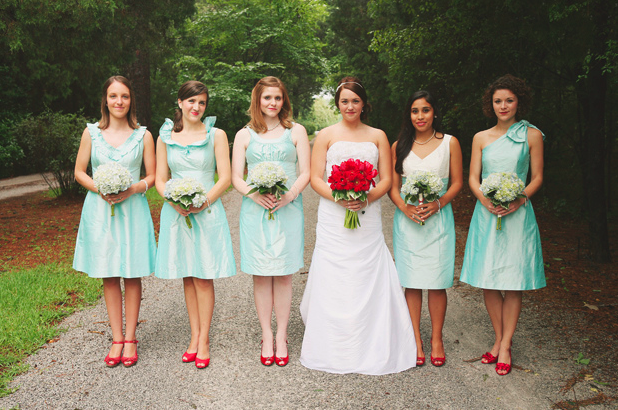 aqua color bridesmaids with red peep toe shoes and bride in middle with red rose bouquet