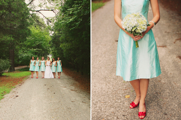 aqua and red wedding colors on display as bridesmaids walk down path