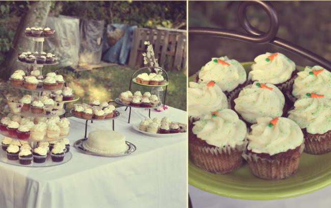 Wedding dessert table with cupcakes covered in sprinkles and mini carrot tops