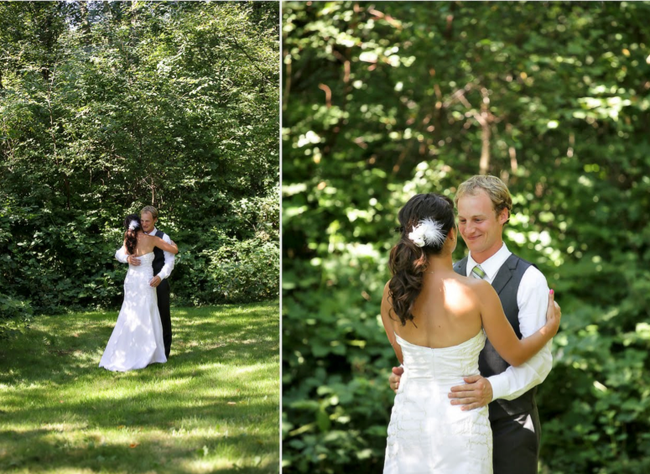 Bride and groom hug in wooded area