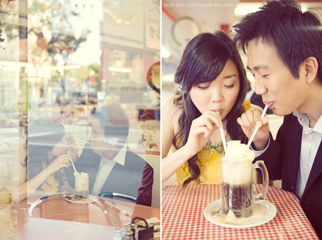 couple with two straws drinking a rootbeer float in a cafe