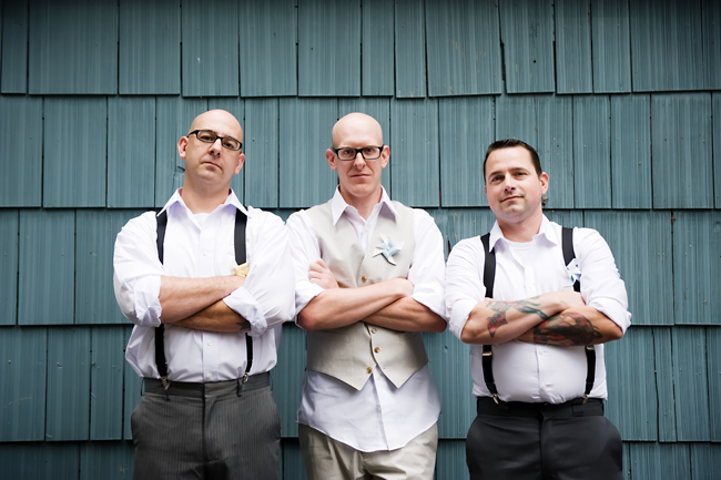 groom and groomsmen in suspenders and open collar white shirts