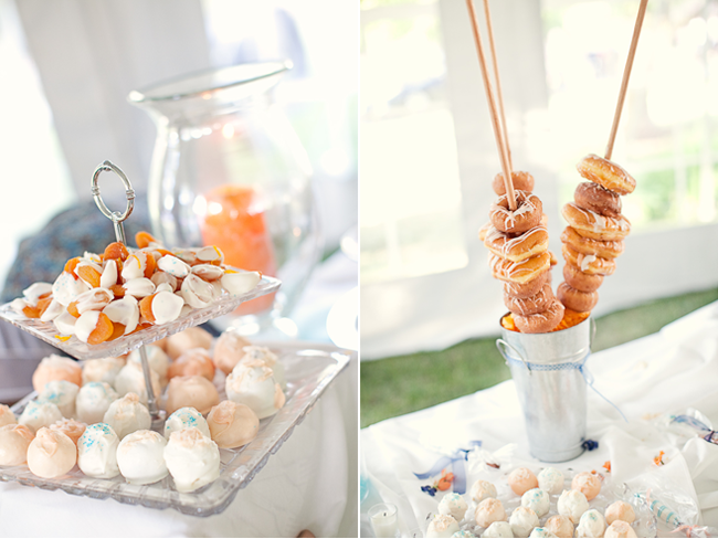 mini donuts on a stick in steel can with other desserts