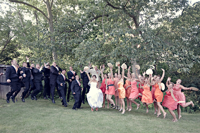 Outdoor park wedding party jump in the air at Old Overlook Park