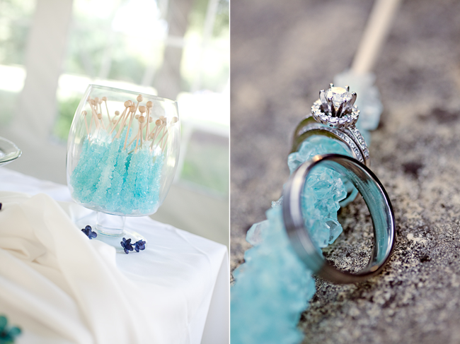 rock candy sticks in jar with wedding rings wrapped around blue rock candy stick