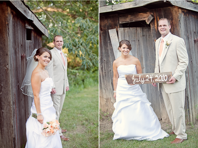 bride and groom hold painted wood sign with their wedding date