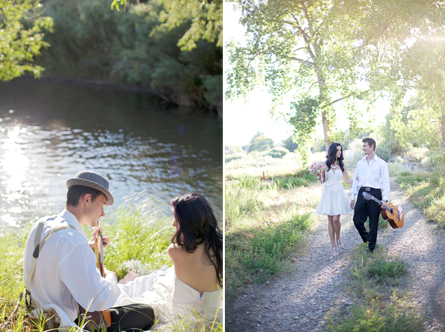 Groom playing guitar to bride as both sit in the sun next to a river