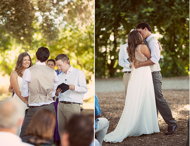 bride and groom kiss at outdoor farm wedding ceremony