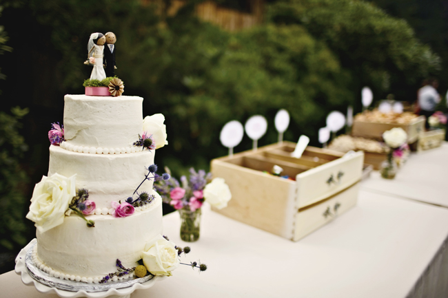 tiered wedding cake with thistle