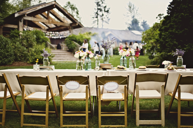outdoor head table with signs