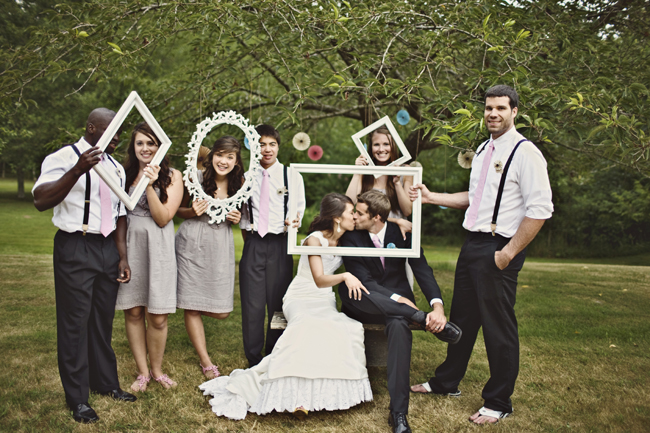 bridal party holding picture frames