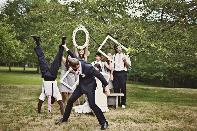 bridal party with photo frames at photo booth