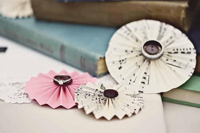 DIY pinwheels: sheet music glued to buttons