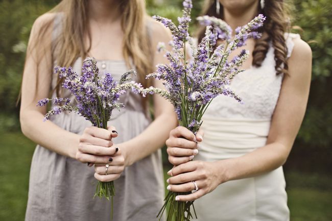 bride and bridesmaid holding lavender bunches