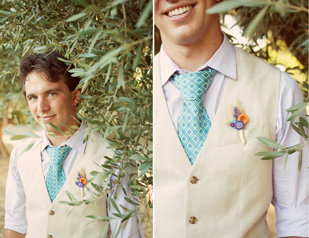 groom with beige vest, aqua pattern necktie, and button boutonniere