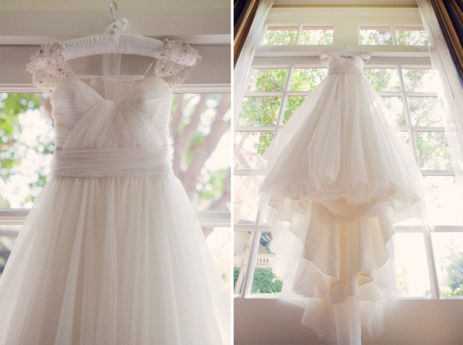 Bridal dress hanging in window at Oakmont Country Club