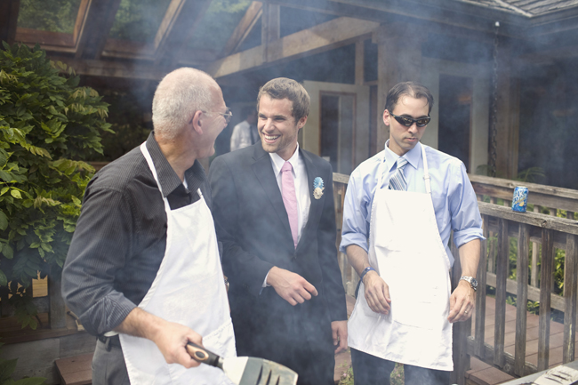 wedding guys at the grill with aprons