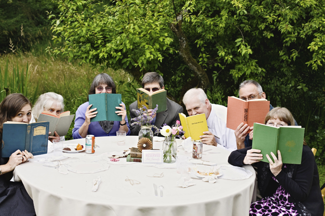 wedding guests holding old books up