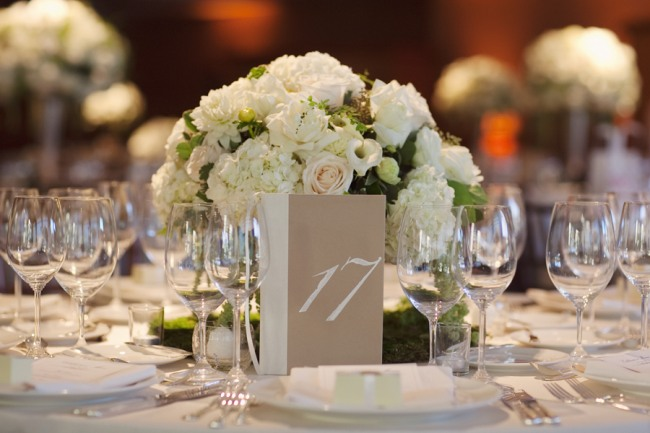 Table setting with white flower centerpiece