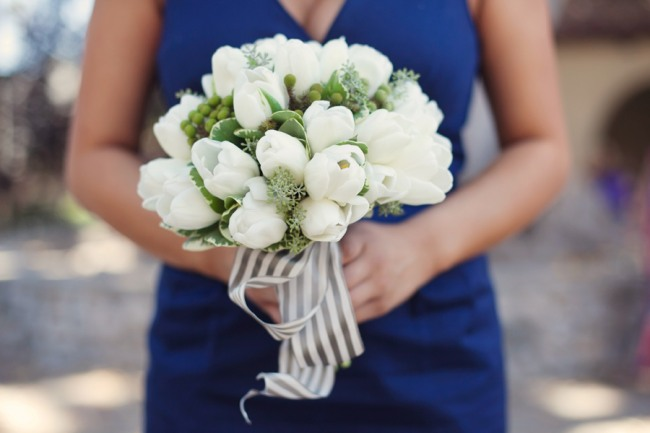 White tulip bridal bouquet with striped ribbon