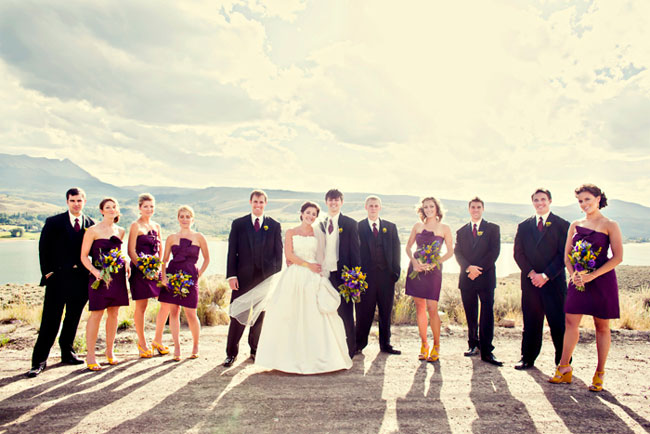 dark purple wedding attire on bridal party standing outdoors in Colorado sun