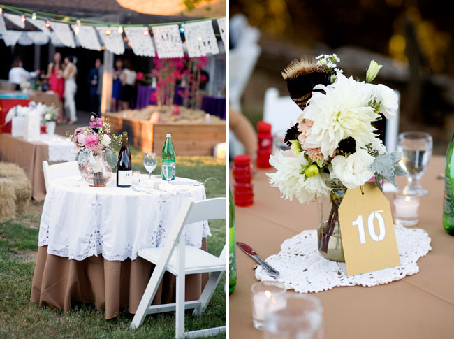reception tables covered with white doilies on taupe linen cloths;  flower centrepieces accentuated with real turkey feathers