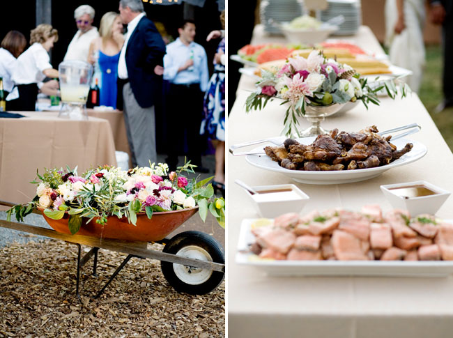 a wheel barrel full of flowers; reception table with food