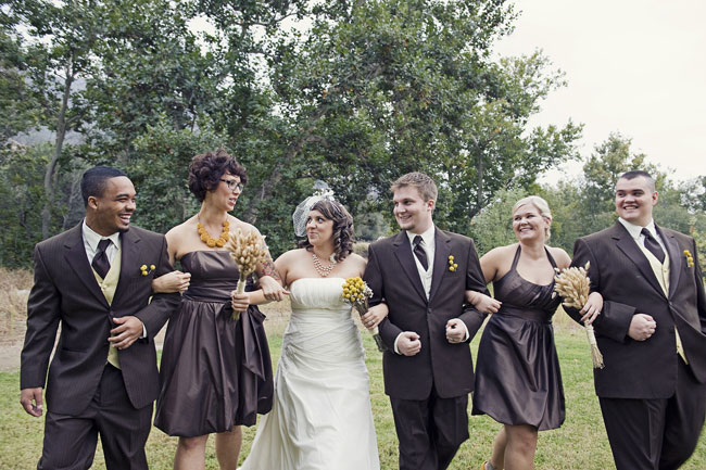 bridal party link arms and walk for wedding at River Ridge Ranch