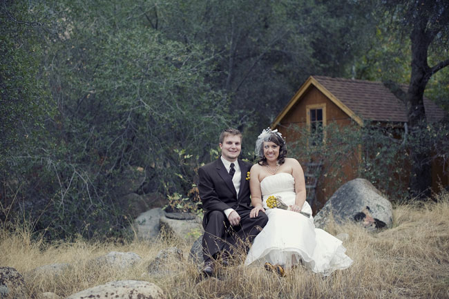 bride and groom sit outdoors at wedding held at River Ridge Ranch, California