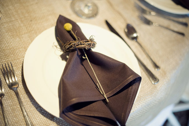 brown napkin with single billy ball, with twig napkin ring