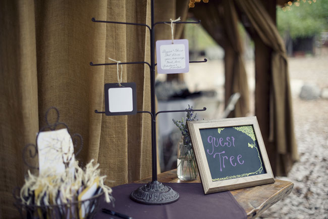 wedding guest book wishing tree with cards hanging on branches
