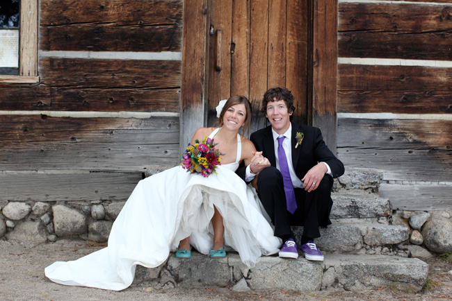 bride and groom on stone steps of Pine Lodge