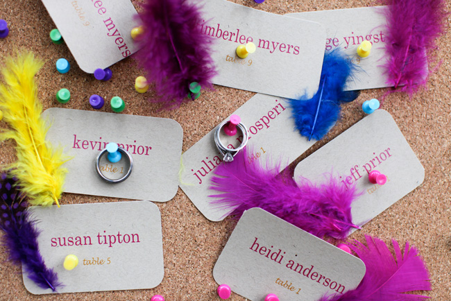 table seating cards and feathers with rings hanging from pushpins