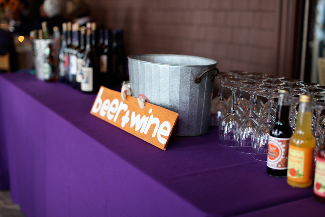 drinks table with purple tablecloth for wedding at pine lodge
