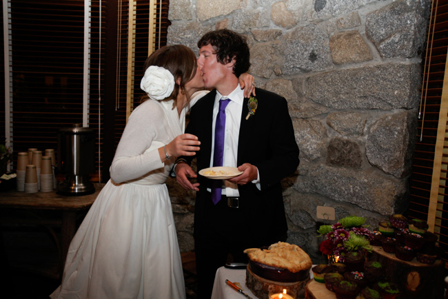 bride and groom sharing a kiss after dinner
