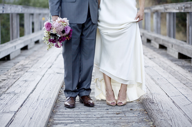 bride and groom displaying their shoes