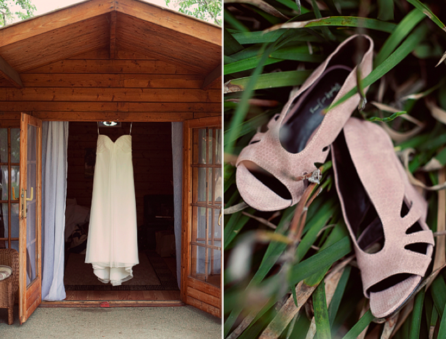 bridal gown hanging in dorrway and pink open toe bridal shoes