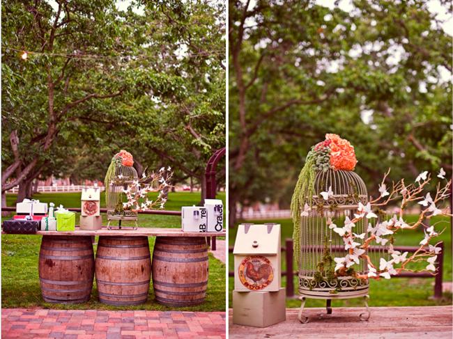Styled California wedding decor: birdcage and details on three wine barrels