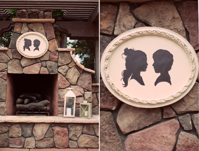 bride and groom silhouette on outdoor rock fireplace